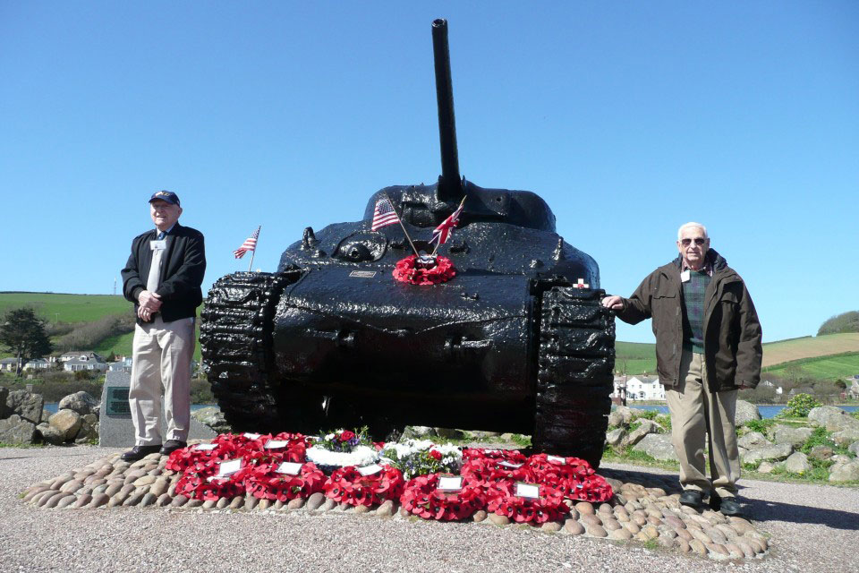 Survivors of Exercise Tiger with the memorial Sherman tank at Slapton Sands