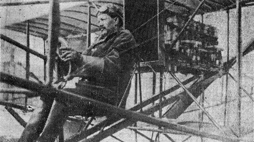 Lucean Arthur Headen at the controls of a biplane