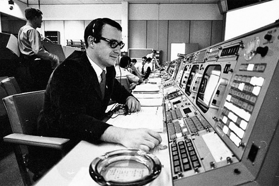 Guidance officer Steve Bales at his Mission Control position. courtesy NASA