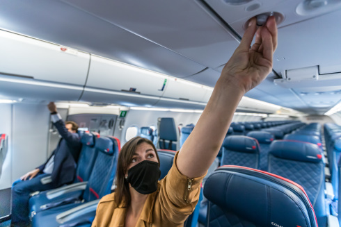 Passengers wearing masks on a plane.