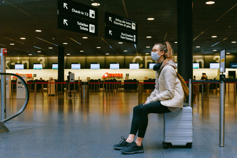 A woman wearing a mask at an Airport